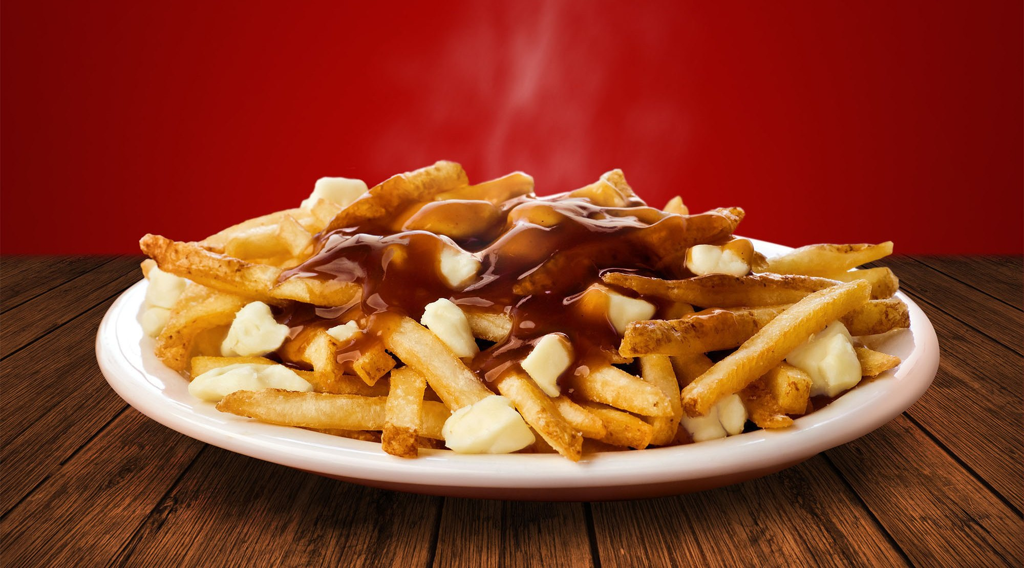 WENDY'S RESTAURANTS OF CANADA - Oh Poutine! Grab your forks