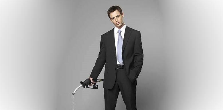 Business man holding petrol pump