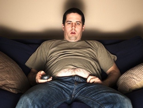 bigstock-Overweight-Slob-Watching-Tv-42507745