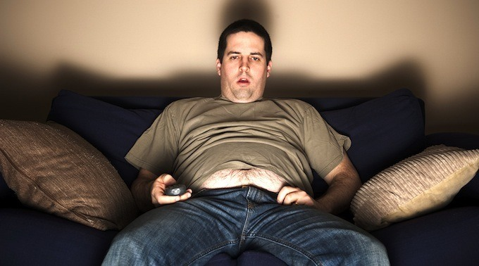 bigstock-Overweight-Slob-Watching-Tv-42507745