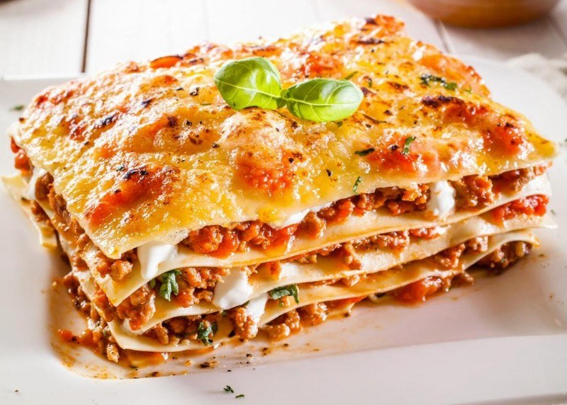 Portion of lasagne with bolognese and cheese