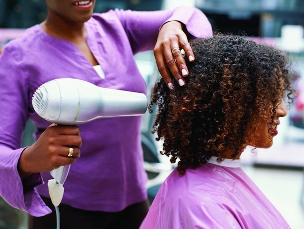 Side Profile of a Woman Having Her Hair Dried with a Hair Dryer --- Image by © Ocean/Corbis