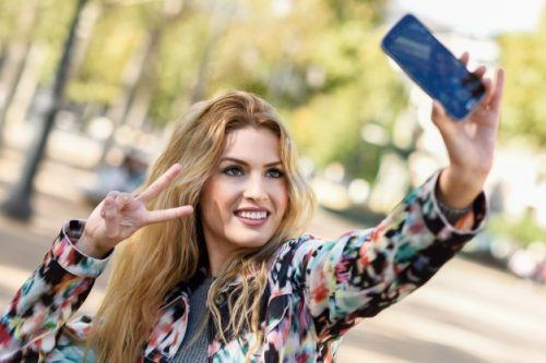Freepik, http://www.freepik.com/free-photo/young-woman-taking-selfie-and-showing-victory-gesture_900036.htm