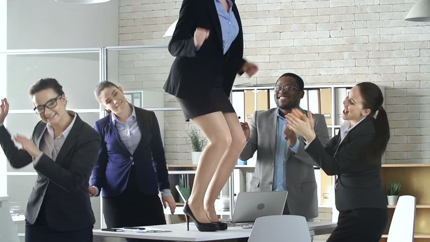 Shutterstock, https://www.shutterstock.com/video/clip-9894788-stock-footage-multinational-business-team-of-five-celebrating-successful-deal-with-a-dance-in-the-office.html